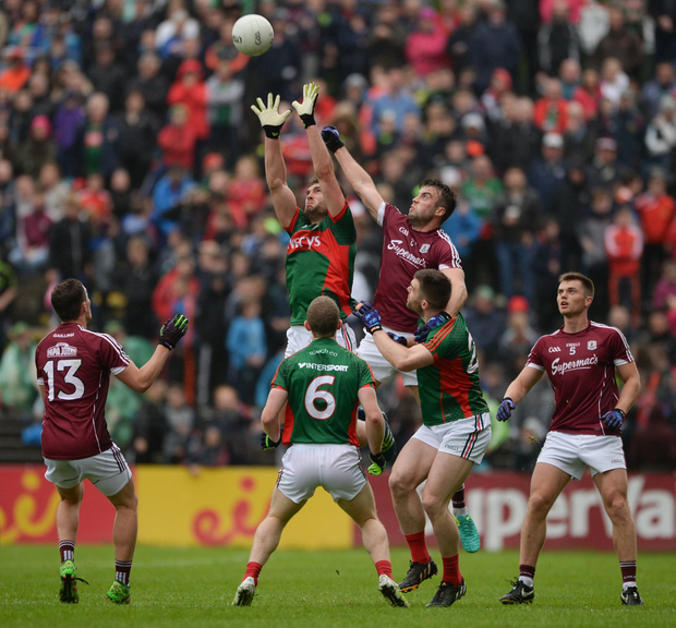 Aidan O'Shea in action against Paul Conroy Photo by Daire Brennan/Sportsfile