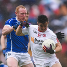 Ronan ONeill is tackled by Cian Mackey Photo by Ramsey Cardy/Sportsfile