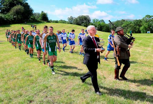 GAA president Aogán Ó Fearghail and a piper before the match between Hertfordshire and Yorkshire at Frongoch in Gwynedd, Wales Photo: Paul Currie/Sportsfile