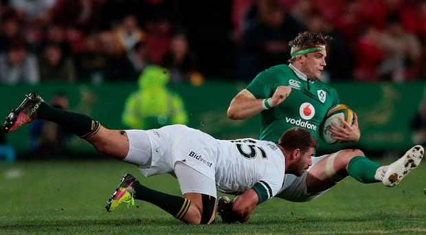 Willie Le Roux tackles Jamie Heaslip during Saturday's match at Ellis Park. Photo: AFP/Getty Images