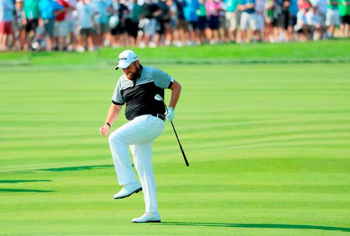 Shane Lowry reacts to a shot on the eighth hole during the final round of the US Open. Inset: Dustin Johnson celebrates with partner Paulina Gretzky and son Tatum after winning his first Major. Photo: Getty Images