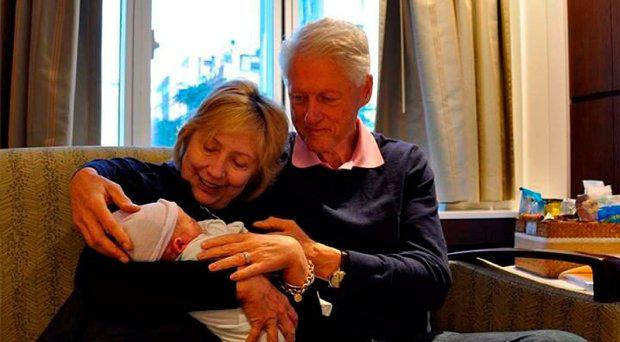 Hillary and Bill Clinton with grandson Aidan Credit: Hillary Clinton
