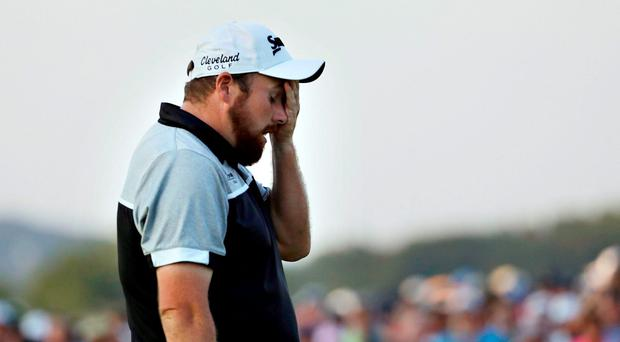 Shane Lowry, of the Republic of Ireland, wipes his face after finishing the final round of the U.S. Open golf championship at Oakmont