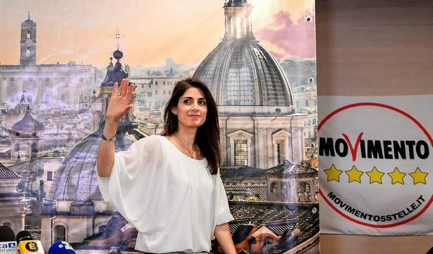 New Rome's Mayor Virginia Raggi of the 5-Star Movement waves at the end of a press conference in Rome, early Monday, June 20, 2016, soon after being elected