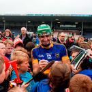 Noel McGrath of Tipperary signs autographs after the Munster GAA Hurling Senior Championship Semi-Final match between Limerick and Tipperary at Semple Stadium in Thurles, Co Tipperary. Photo by Daire Brennan/Sportsfile