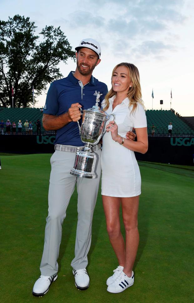 Dustin Johnson poses for a photo with fiance Paulina Gretzky while holding the championship trophy after winning the U.S. Open golf tournament at Oakmont Country Club. Mandatory Credit: John David Mercer-USA TODAY Sports