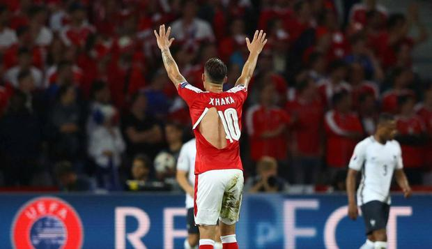 75bba3f3511 Granit Xhaka s shirt is clearly ripped during Switzerland s match with  France. Getty