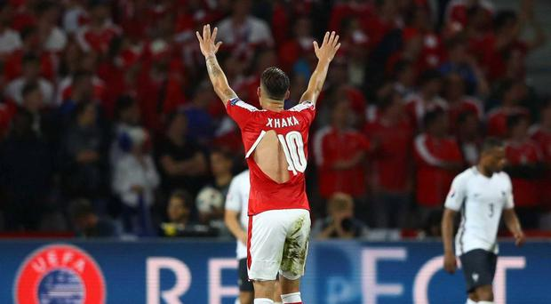 Granit Xhaka's shirt is clearly ripped during Switzerland's match with France. Getty