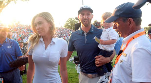 Dustin Johnson walks off the 18th green with fiance Paulina Gretzky while holding their son Tatum after winning the U.S. Open golf tournament at Oakmont. Credit: Michael Madrid-USA TODAY Sports