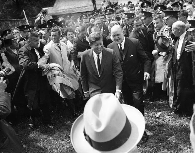 American President John Fitzgerald Kennedy (J.F.K)'s visit to Ireland, June 1963. JFK walking with a smile amongst crowd. (Part of the Independent Ireland Newspapers/NLI Collection)