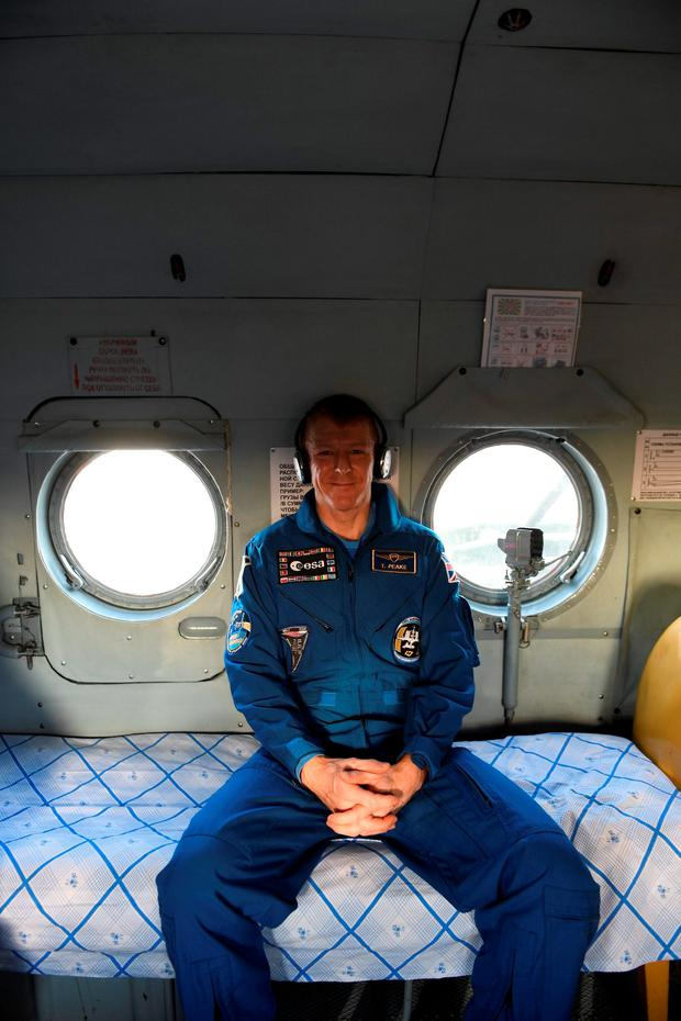 Handout file photo issued by the European Space Agency dated 18/06/16 of Major Tim Peake in a recovery helicopter shortly after landing in Kazakhstan, as the British astronaut said he feels like he is having the