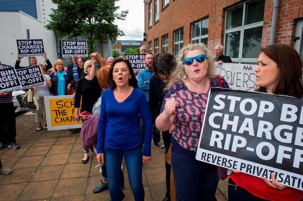 Simon Coveney presence at Council meeting attracts activists demonstrating against the bin charges. Photo: Doug O'Connor
