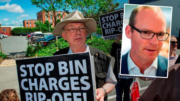 John Ward, Walkinstown, demonstrates against the bin charges. (Inset: Minister Simon Coveney) Photo: Doug O'Connor