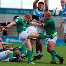 Stephen Keirns of Ireland (C) clears the ball during the World Rugby U20 Championship Semi Final between Ireland and Argentina