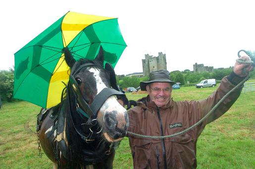 Peter Coffey from Dunderry keeping his horse Trigger dry at the Trim Haymaking Festival. Photo: Seamus Farrelly.