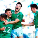 Shane Daly, second from left, of Ireland celebrates scoring a late try