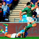 Max Deegan of Ireland escapes a tackle on his way to scoring a try. Photo: Sportsfile