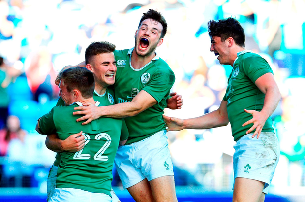 Shane Daly, second from left, of Ireland celebrates scoring a late try with team-mates. Photo: Sportsfile