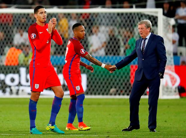 England head coach Roy Hodgson and Nathaniel Clyne shake hands at full time as Chris Smalling applauds fans