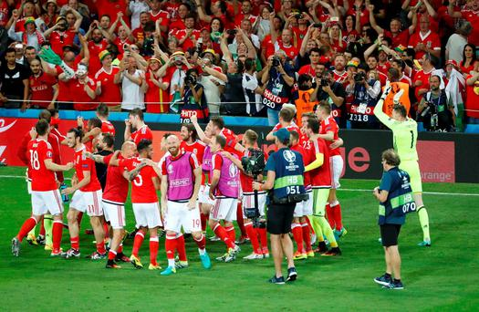 Wales' players celebrate after the match