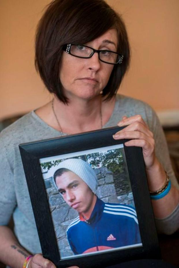 Elaine Hughes with a picture of her son Darren, who tragically took his own life in 2012