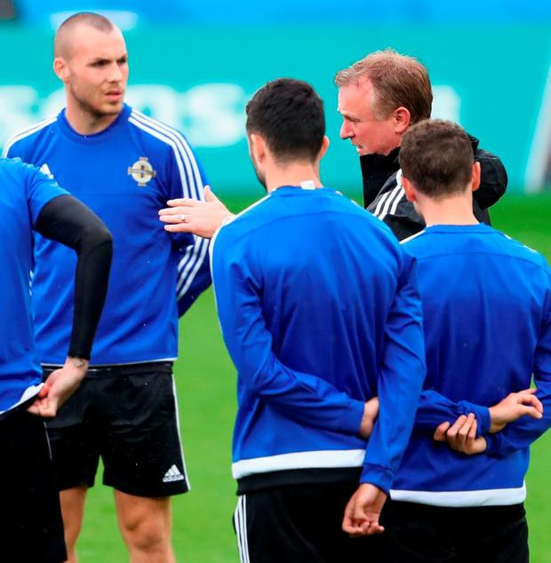 Northern Ireland manager Michael O'Neill talks to his players during a training session ahead of this evening's Group C match against Germany at the Parc de Princes Photo: Alexander Hassenstein/Getty Images