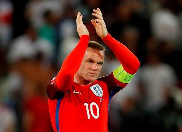 England's Wayne Rooney applauds the fans at the end of the game Photo: REUTERS/Lee Smith