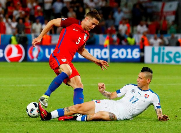 England's Gary Cahill in action with Slovakia's Marek Hamsik Photo: REUTERS/Jason Cairnduff