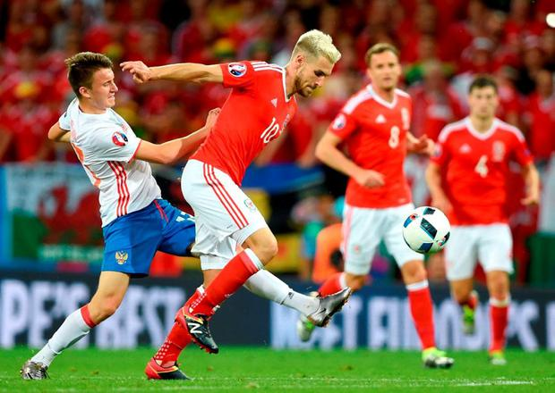 Russia's Aleksandr Golovin (left) and Wales' Aaron Ramsey battle for control of the ball Photo: Joe Giddens/PA Wire