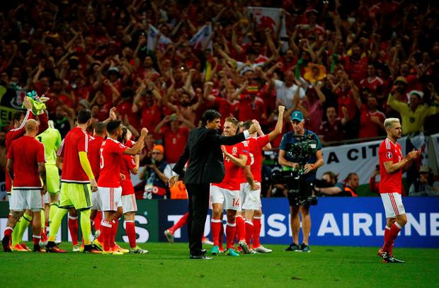Wales' players celebrate after the match Photo: REUTERS/Sergio Perez