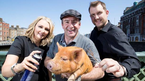Maurice Walsh with salon owners Claire and Nick Reddin.