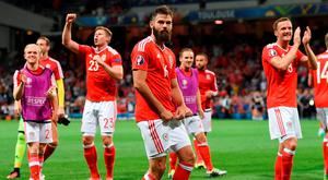Wales' midfielder Joe Ledley (C) celebrates with teammates their 3-0 win in the Euro 2016 group B football match between Russia and Wales at the Stadium Municipal in Toulouse