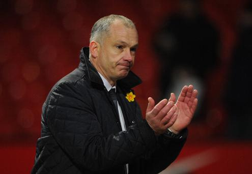 MANCHESTER, ENGLAND - MARCH 16: Reading Caretaker Manager Eamonn Dolan applauds the fans at the end of the Barclays Premier League match between Manchester United and Reading at Old Trafford on March 16, 2013 in Manchester, England. (Photo by Michael Regan/Getty Images)
