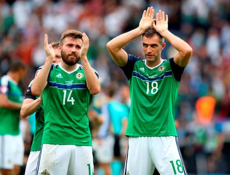 Northern Ireland's Stuart Dallas (left) and Aaron Hughes applaud the fans