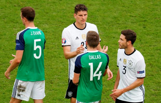 Germany's Mario Gomez shakes hands with Northern Ireland's Stuart Dallas after the game