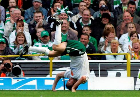 Robbie Keane celebrates his goal against Celtic, during the Jackie McNamara testimonial match at Celtic Park in May 29, 2005, with his trademark cartwheel. Pic: Steve Welsh/PA.