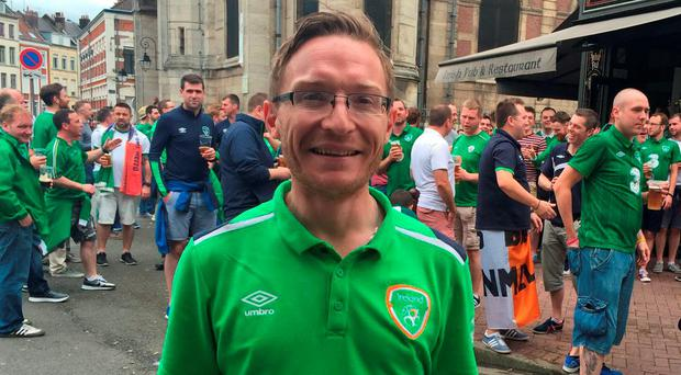 Ireland fan Alan Maxwell was helped by locals after attack