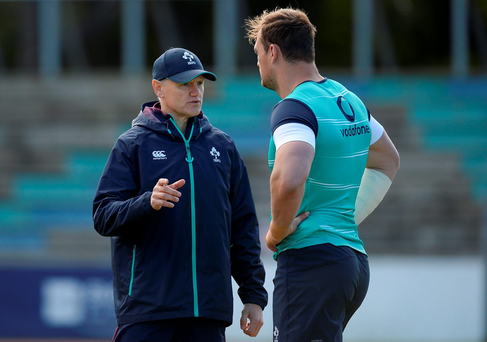Joe Schmidt talks to Rhys Ruddock during the Irish training session in Port Elizabeth yesterday. Photo by Brendan Moran/Sportsfile