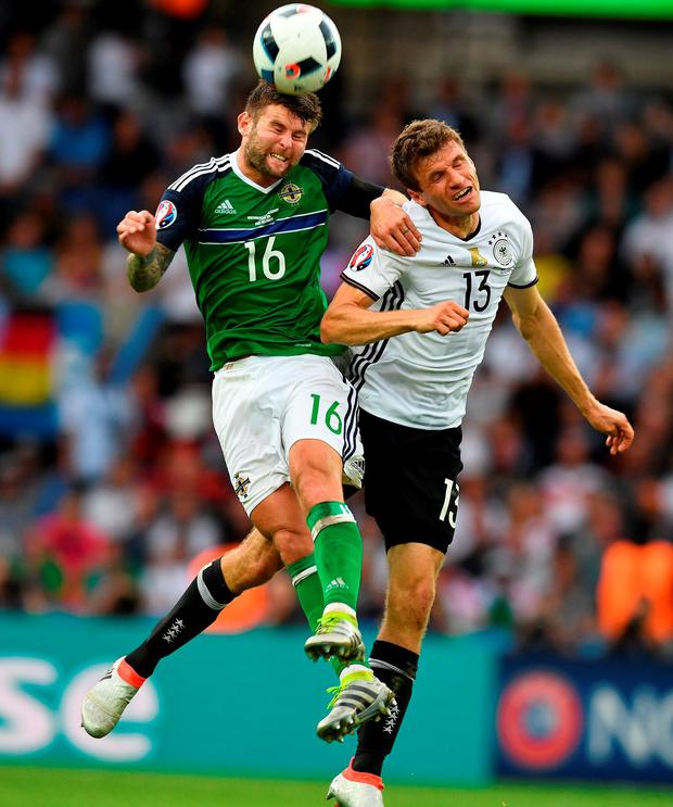 Oliver Norwood (L) of Northern Ireland and Thomas Muller battle for possession. Photo: Getty
