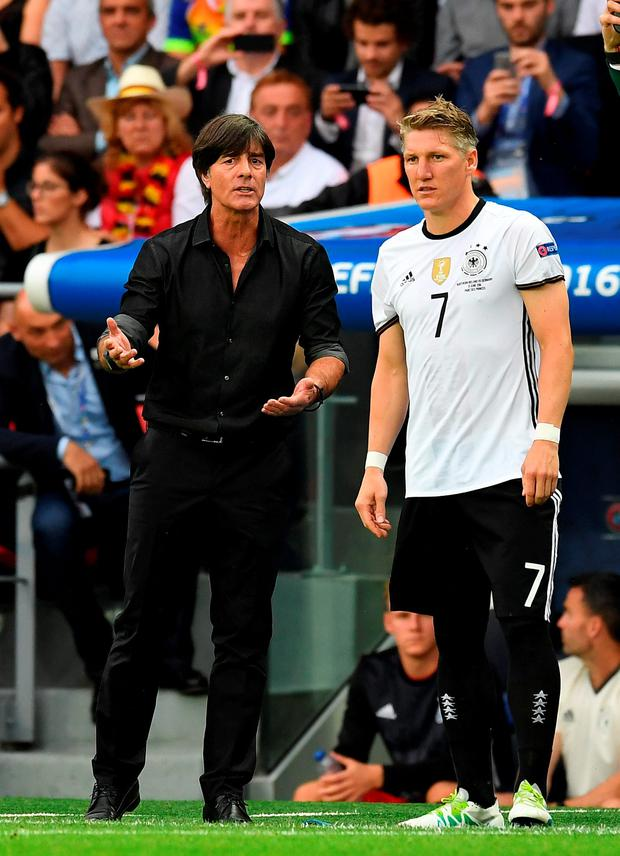 Germany manager Joachim Low and Bastian Schweinsteiger. Photo: Getty