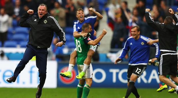 LYON, FRANCE - JUNE 16: Michael O'Neill (L) manager of Northern Ireland celebrates his team's second goal during the UEFA EURO 2016 Group C match between Ukraine and Northern Ireland at Stade des Lumieres on June 16, 2016 in Lyon, France. (Photo by Julian Finney/Getty Images)