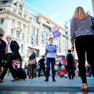 "Campaigners from the ""Vote Remain"" group hand out stickers, flyers and posters in Oxford Circus, central London. Getty Images"