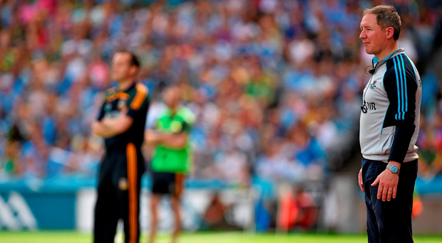Meath manager Mick O'Dowd in the backround with Dublin boss Jim Gavin during the 2014 Leinster final. Picture credit: Barry Cregg / SPORTSFILE