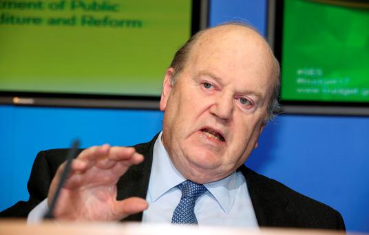 As he reaffirmed plans to abolish the much-hated Universal Social Charges by 2021, Mr Noonan said he was proceeding on the basis the Government will survive at least three years. Pic Tom Burke