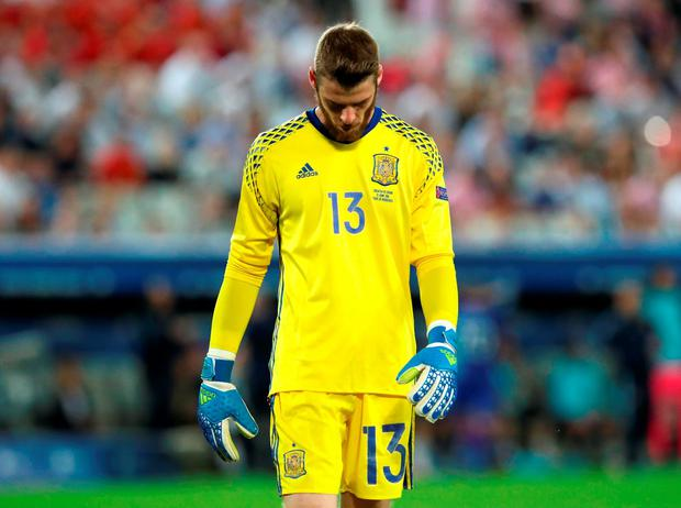 Spain goalkeeper David De Gea walks off the pitch at the end of the match: Photo: AP