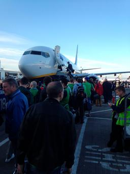 Ireland fans wait at Dublin Airport as their 6.30am flight failed to depart