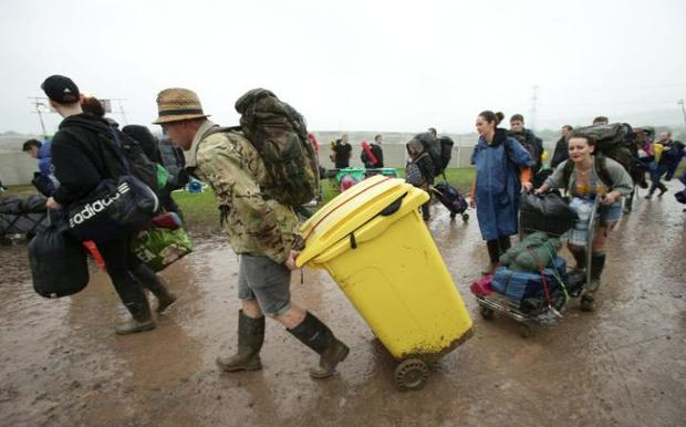 Glastonbury fans think up inventive ways to transport their luggage. Photo: PA
