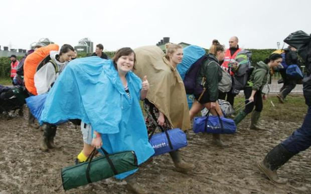 What mud? Festival-goers arrive at Worthy Farm. Photo: PA