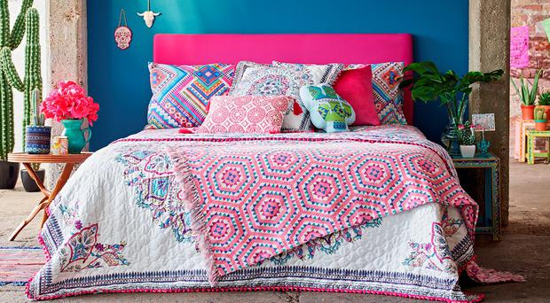Quilted throw, €20, patterned throw, €12, diamond aztec double, €16, patterned cushions from €6 at Penneys