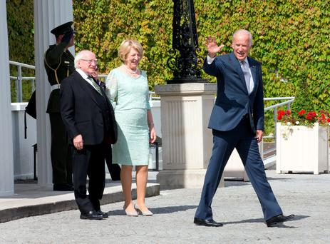 US Vice President Joe Biden waves goodbye as he leave Áras an Uachtaráin this morning as President Michael D Higgins and his wife Sabina look on. Photo: Tony Gavin